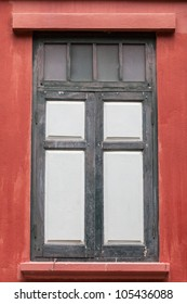 Old wooden windows are closed.