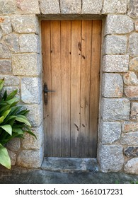 old wooden windows and wooden doors with fittings on Mallorca in the sun