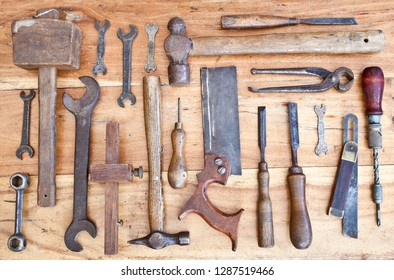 Old woodwork tools on grungy wooden bench background
