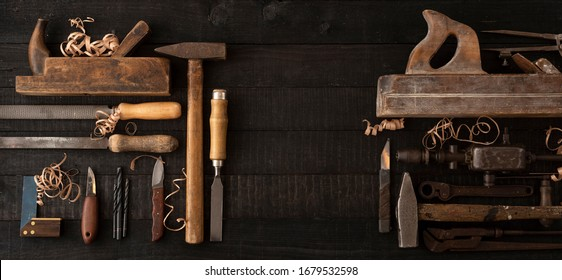 Old woodworking tools on a dark workbench with copy space: carpentry, joinery concept, flat lay