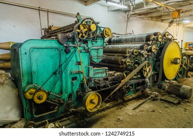 Old wool processing machine. Carding of wool equipment.