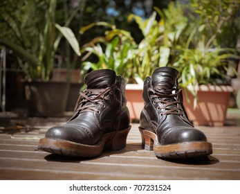 Old Working Leather Boots on Ground Floor background