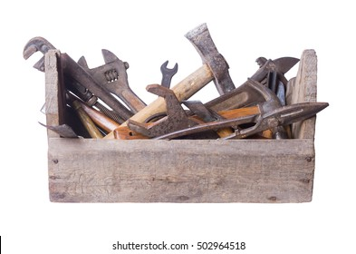 Old working tools in an old box on white background