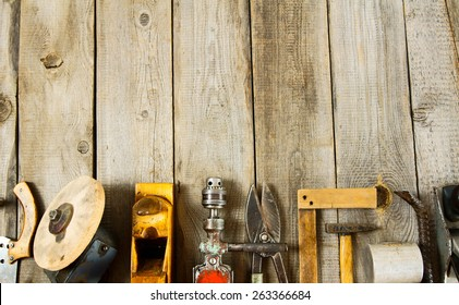 Old working tools. Many working tools on a wooden background.