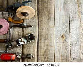 Old working tools. Various tools on a wooden background.
