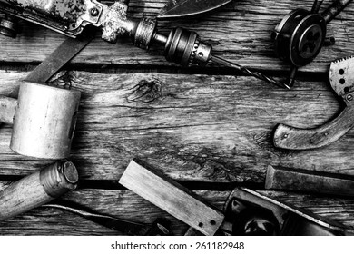 Old working tools. Vintage working tools on wooden background.