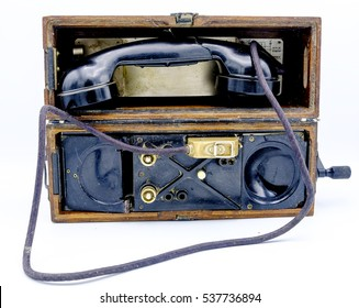 Old World War II military phone in wooden box. Isolated