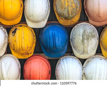 Old and worn colorful construction helmets