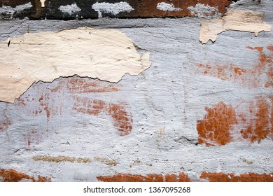 Old worn damaged cracked wall with peeling paint. Abstract texture background