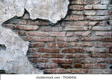 An old worn down red brick wall with plaster on the sides make a great background with copyspace