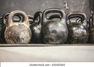 Old worn dumbells in gym