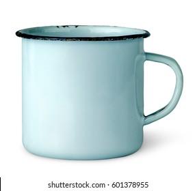 Old worn enameled mug isolated on white background