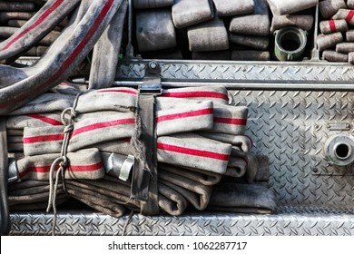 Old worn firehose on a firetruck, shallow focus