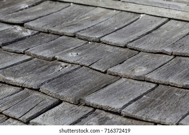 Old, worn and grey wooden shingles.
