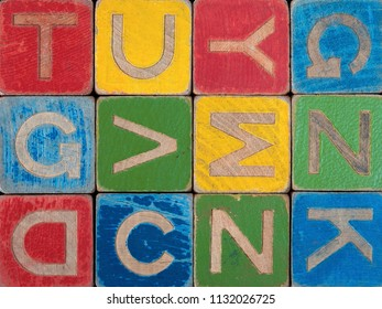 Old and worn letter building blocks