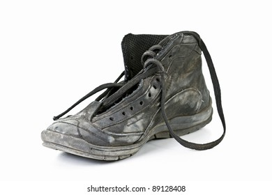 Old worn out black shoes on white background