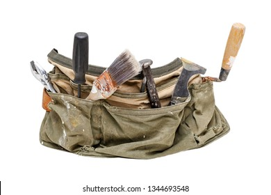 Old worn out utility belt filled with tools. Shaped to wrap around body of subject.