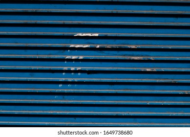 Old worn painted Blue metal shutter