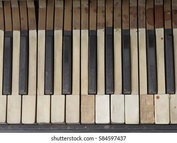 Old worn piano keyboard
