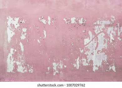 Old and worn pink wall used for urban posters