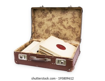 Old worn suitcase filled with old records