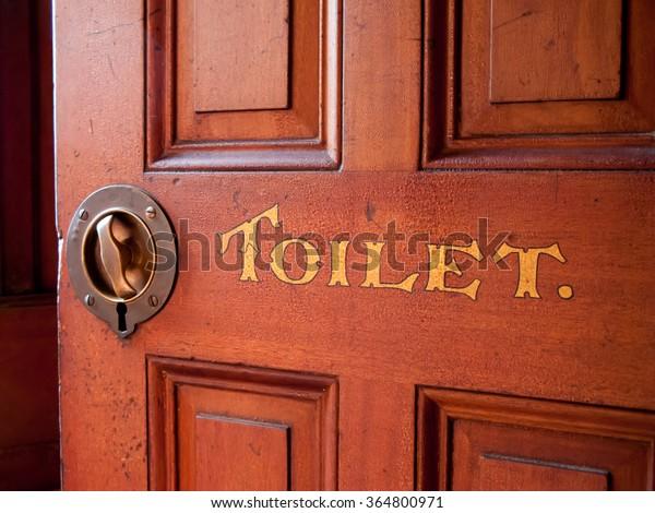 old worn Victorian bathroom door