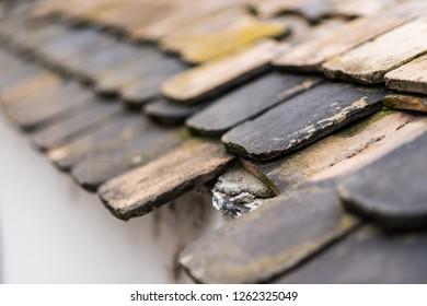 Old worned tile roof close up image
