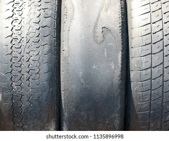 old worn-out summer tires with worn-out protector close-up