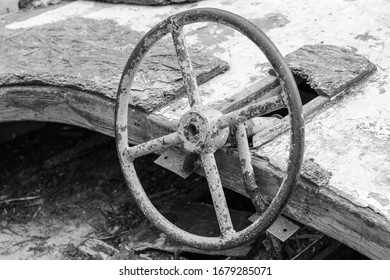 Old wrecked boat on land. Black and white photo.