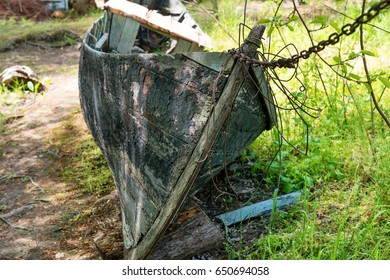 Old wrecked fishing boat on the river bank
