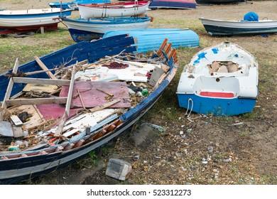 Old Wrecks of fishing sloop on Sicilian beach