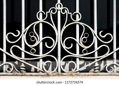 Old wrought iron grating with floral decorations