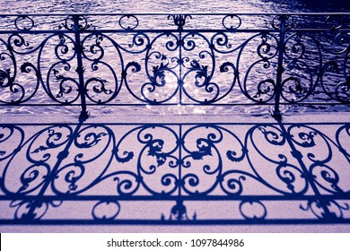 Old wrought iron railing on a walkway in Lucerne (Switzerland) - toned image