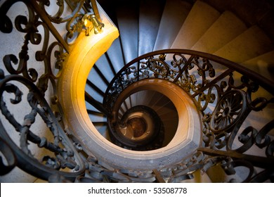 Old wrought spiral staircase in Versailles Chateau. France Shallow DOF