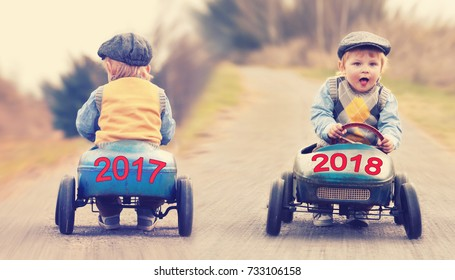 old year 2017 on a vintage old toy car leaving, new year 2018 on a vintage old toy car is coming