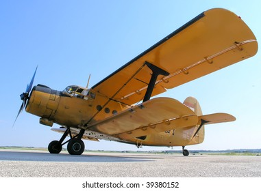 Old yellow airplane with double wings