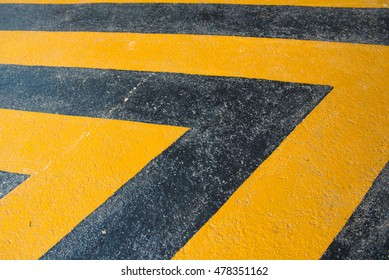old yellow and black painted cement floor background