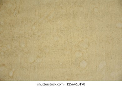 Old yellow boards are filled with droplets caused by condensation and moisture.