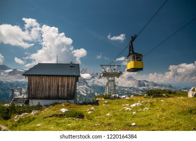 Old yellow cableway on nice day in the Alps
