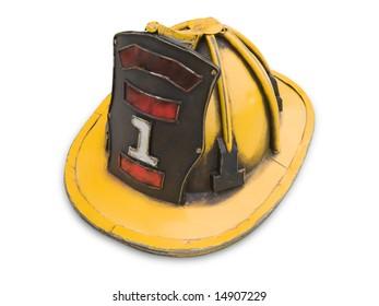 Old yellow fireman helmet isolated on white.
