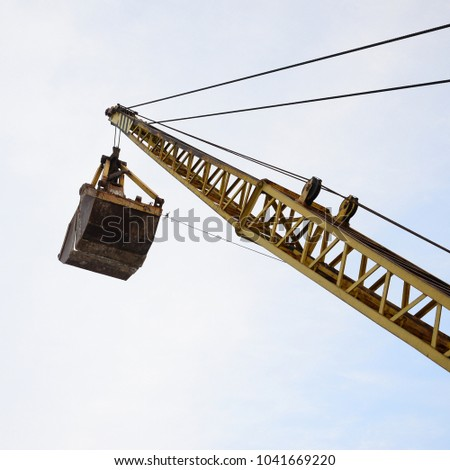 Old Yellow Mechanical Clamshell Grab On Stock Photo (Edit Now
