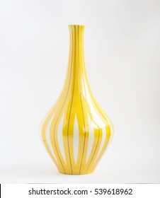 Old yellow porcelain vase isolated