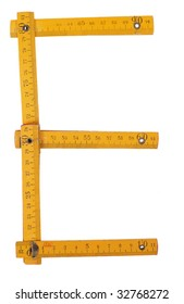 old yellow ruler forming font symbol E