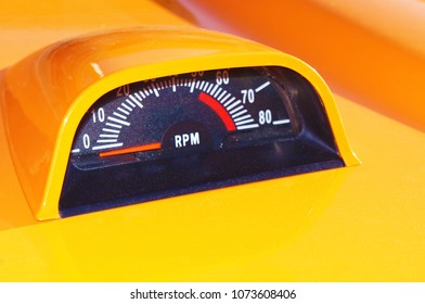 Old yellow sport car tachometer RPM counter showing zero