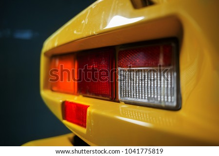 Old yellow supercar taillight
