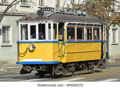 Old yellow tram in the city