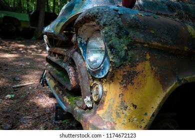 Old Yellow Truck In Junkyard