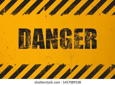 Old yellow weathered painted background with grunge black danger sign and stripes