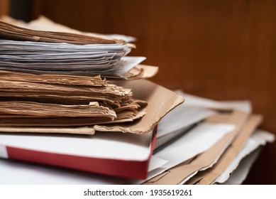 Old yellowed manuscripts lie in a stack, beautiful paper background, there is place for text. A book typed on a manual typewriter was brought to the publishing house to publish a book