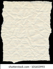 Old yellowing crumpled lined paper torn edges isolated on black.